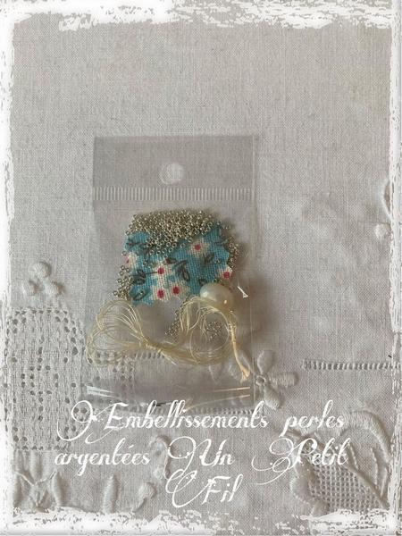 Perles argentees embellisements un petit fil